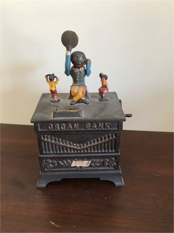 Cast Iron Book of Knowledge Mechanical Bank - Organ Grinder